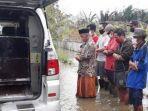 pemakaman-pasien-covid-19-di-kabupaten-pekalongan-yang-terendam-banjir.jpg