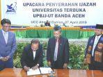 pemimpin-perusahaan-serambi-indonesia-mohd-din-bersama-direktur-upbjj-ut.jpg
