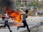 pemuda-demonstrasi-di-tepi-barat-palestina.jpg