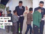 pengantin-yang-membagikan-amplop-untuk-anak-yatim-di-hari-pernikahannya.jpg