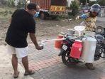 penjual-susu-keliling-di-india.jpg