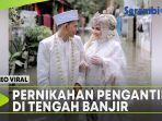 pernikahan-pengantin-baru-di-tengah-banjir-viral.jpg