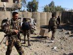 personel-keamanan-afghanistan-berjaga-di-lokasi-serangan-bom-mobil-di-lashkar-gah_20180224_225925.jpg
