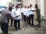 peserta-ujian-cpns-di-kabupaten-aceh-singkil-diperiksa-gunakan-detektor.jpg