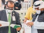 petugas-memeriksa-id-card-di-arab-saudi.jpg
