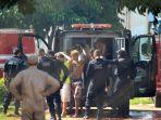 petugas-polisi-membawa-narapidana-kembali-ke-penjara-di-brazil_20180103_125100.jpg