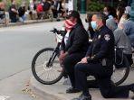polisi-berlutut-di-amerika-serikat-saat-demo-george-floyd.jpg