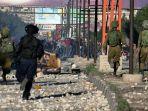 polisi-israel-terlibat-bentrok-dengan-warga-palestina_20171208_231755.jpg