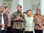 presiden-joko-widodo-didampingi-ketua-kpk-abraham-samad.jpg