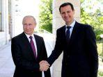 presiden-rusia-vladimir-putin-kiri-dan-presiden-suriah-bashar-al-assad_20180607_225004.jpg