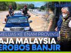 raja-malaysia-kemudikan-mobil-terobos-banjir-yang-menutupi-badan-jalan.jpg