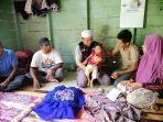 relawan-aksi-cepat-tanggap-simeulue-menyerahkan-bantuan-untuk-penderita-gizi-buruk.jpg