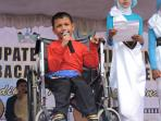 reza-maulana-murid-cacat-dari-sekolah-luar-biasa_20160212_092219.jpg
