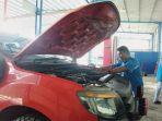 technical-service-ford-aceh-sedang-melakukan-service-mobil-ford_20170919_090117.jpg