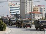 tentara-israel-saat-memasuki-wilayah-ramallah-di-tepi-barat-pada-senin-10122018.jpg