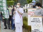 tim-media-dan-warga-demo-menentang-olimpiade-tokyo.jpg
