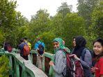 turis-singapura-ke-wisata-mangrove_20161124_155759.jpg