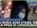 video-populer-ibu-muda-aceh-utara-di-medan-bawa-obor-keliling-desa-sampai-macet-ppkm-di-lhokseumawe.jpg