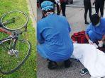 viral-sempat-mengira-benda-jatuh-dari-truk-ternyata-seorang-pesepeda-perempuan-terlindas.jpg