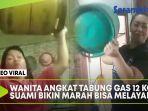 wanita-angkat-tabung-gas-12-kg.jpg