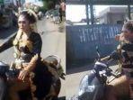wanita-yang-memakai-pakaian-pengantin-mengendarai-motor-sendiri-dan-melintasi-jalan-raya.jpg