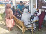 warga-gampong-bangka-jaya-kecamatan-dewantara-aceh-utara-mengikuti-pengobatan.jpg