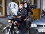 warga-iran-pakai-masker.jpg