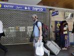 warga-israel-tetap-memakai-masker.jpg