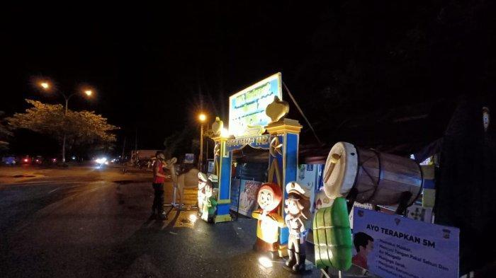 AMBON; Posko penjagaan Operasi Ketupat Siwalima 2022 di JMP Kawasan Poka, Teluk Ambon, Ambon, Rabu (5/5/2021) malam.