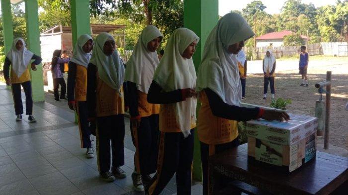 Jumat Sadaqah, Cara Disdikbudpora Bangun Pendidikan di Seram Bagian Timur
