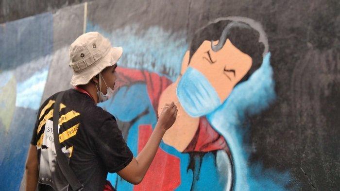 Lomba Mural di Ambon, Aldo Jamlay: Superman Saja Pakai Masker