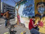 2242021-seniman-mural-palestina.jpg