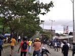 mahasiswa-terlibat-aksi-lempar-batu-dalam-aksi-unjuk-rasa.jpg