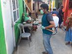 pemuda-di-ambon-semprot-disinfektan-keliling-perkampungan.jpg