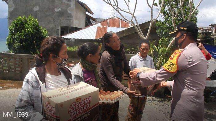 Anggota Polres Bangli Sisihkan Gaji Demi Bantu Warga Terdampak Pandemi Covid-19