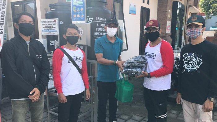 Bangun Sinergi, PK APHB Denpasar dan DPC Persadha Nusantara Denpasar Salurkan Bantuan