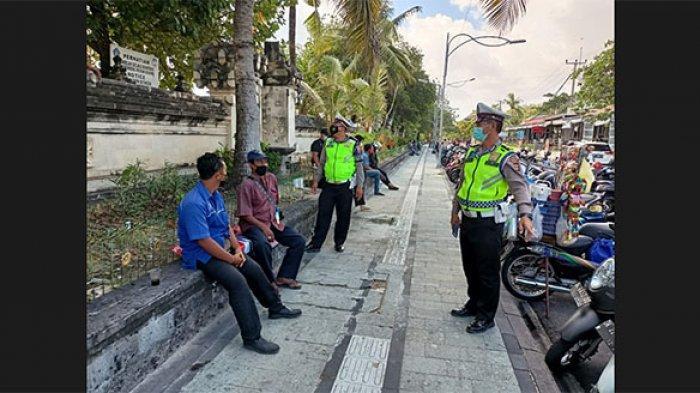 Datangi Tempat Wisata, Kasat Lantas Polresta Denpasar Sosialisasikan Aturan Ganjil Genap Kendaraan