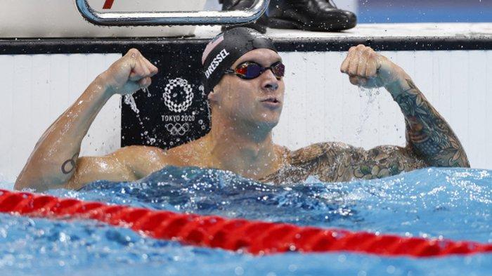Caeleb Dressel dari Amerika Serikat bereaksi setelah memecahkan rekor Olimpiade dan merebut emas di final nomor 50m gaya bebas putra  Olimpiade Tokyo 2020 di Tokyo Aquatics Center, 1 Agustus 2021.