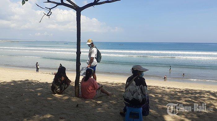 Nyanyi Sunyi Penjaja Jasa Tato Temporer di Pantai Kuta, Bisa Seminggu Tanpa Pelanggan Akibat Pandemi