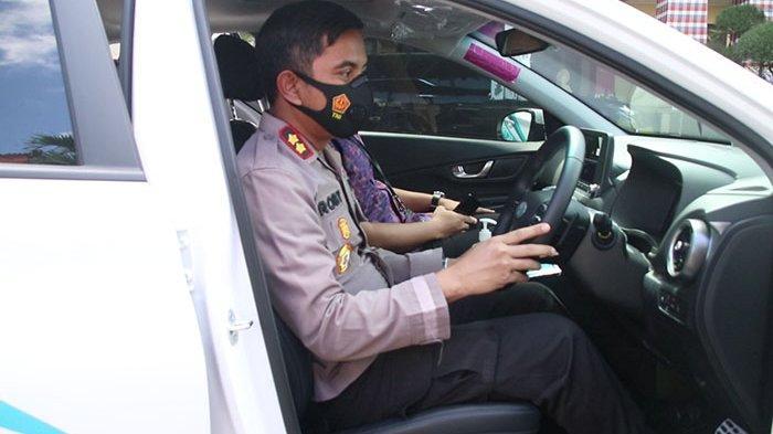 Sambangi Mapolres Badung Jalin Silaturahmi, PLN Bali Selatan Perkenalkan Mobil Listrik ke Kapolres