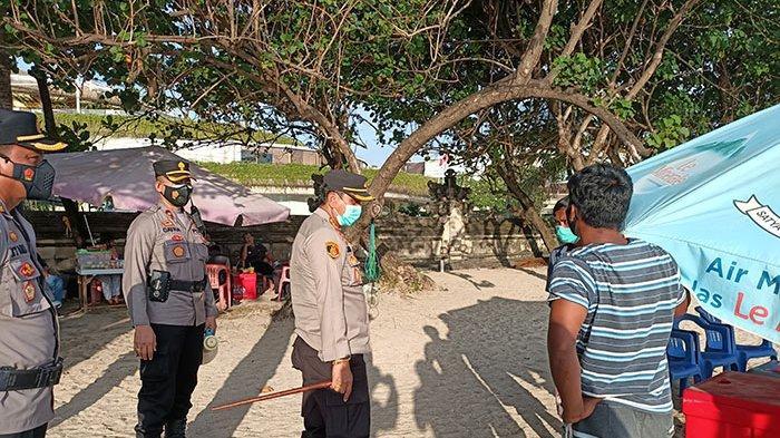 Atensi Keramaian Wisawatan di Pantai Kuta Bali, Polisi Beri Imbauan Disiplin Protokol Kesehatan