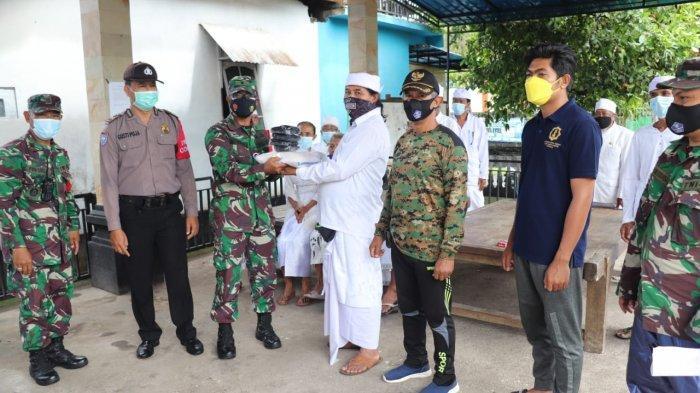 Kodim 1610 Klungkung dan Polres Klungkung Salurkan Bantuan Sembako di Klungkung