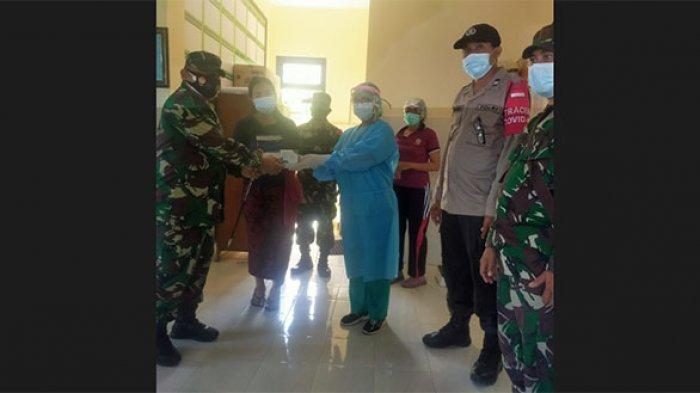 Kodim Klungkung Salurkan Bantuan Obat Bagi Warga Terpapar Covid-19 di Desa Tangkas