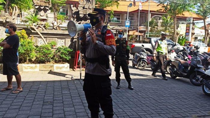 Kapolsek Kuta Ingatkan Warga untuk Taat Prokes Khususnya Saat Menerima BST