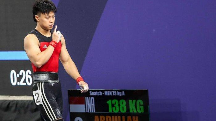 HASIL Angkat Besi Olimpiade Tokyo 2021: Rahmat Erwin Terbaik di Grup B, Peluang Bersaing di 8 Besar