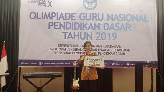 Wakili Bali, Dewi Ersani Raih Perunggupada Olimpiade Guru Nasional 2019
