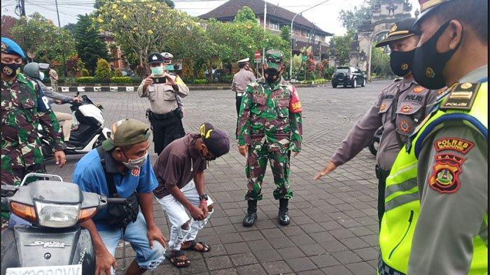 Tim Penindak Yustisi Agung Covid-19 Tindak Pelanggar Prokes di Pasar Mengwi Badung