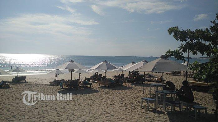 Begini Pesona Matahari Terbenam dan Pasir Putih di Pantai Jimbaran yang Wajib Dikunjungi