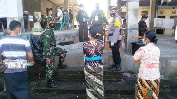 Situasi pelaksanaan Pilkel di Banjar Lambing, Desa Mekar Bhuana, Kecamatan Abiansemal, Kabupaten Badung, Bali, 7 Februari 2021.