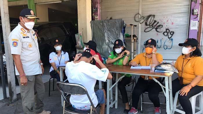 Tim Yustisi Denpasar Jaring 15 Warga di Pedungan, Pelanggar Diminta Tandatangani Surat Pernyataan